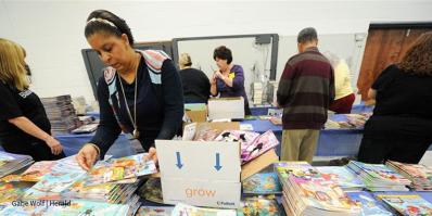 Teachers sorting books