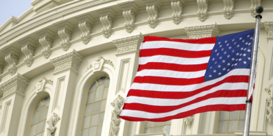 US flag waving in front of government building