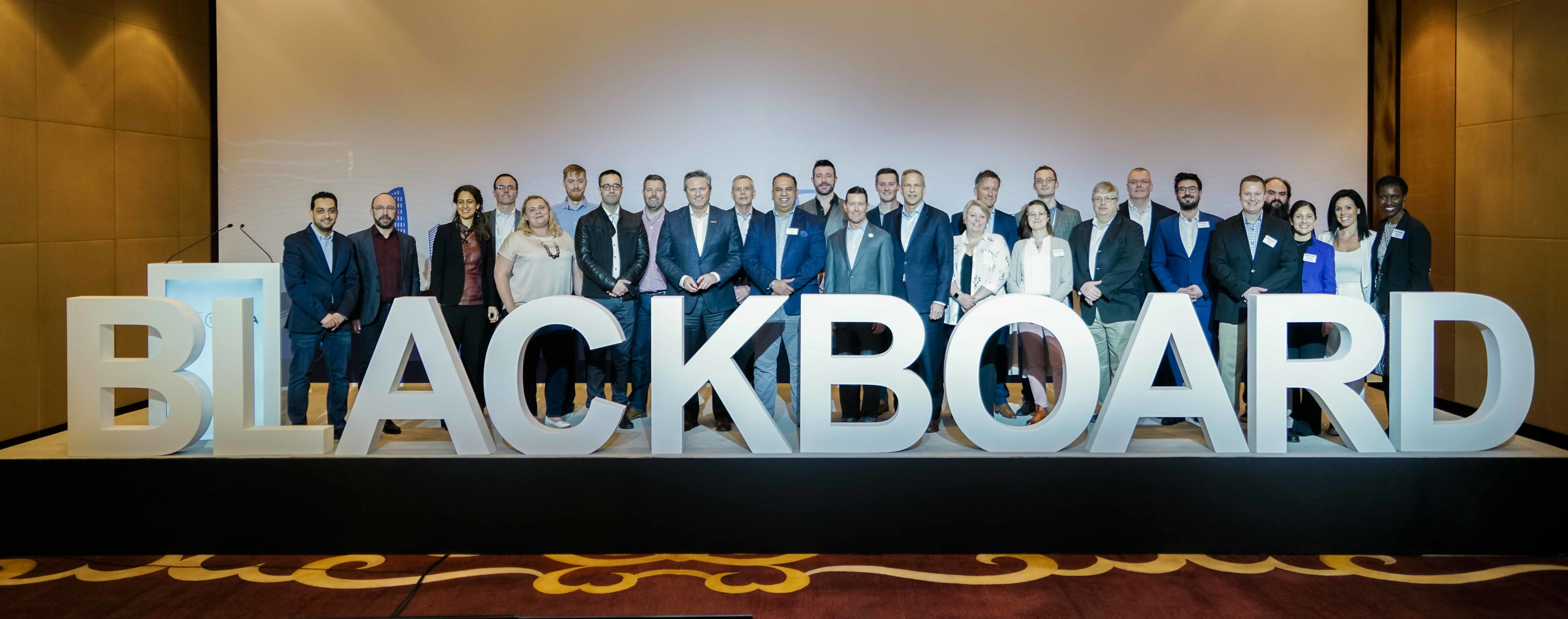 2018 TLC attendees standing behind large letters that spell out 'BLACKBOARD'