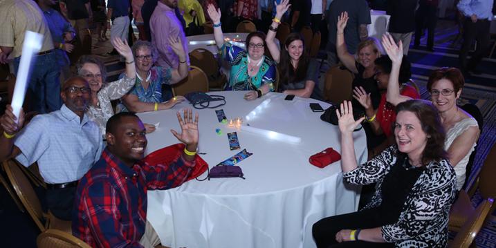 Our community members waving at BbWorld