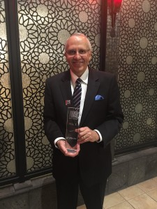 Ken Barber, Jiffy Lube International's learning & development manager accepts the Training Magazine award.